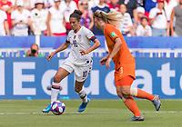 LYON,  - JULY 7: Carli Lloyd #10 dribbles around Stefanie van der Gragt #3 during a game between Netherlands and USWNT at Stade de Lyon on July 7, 2019 in Lyon, France.