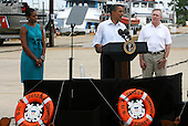 United States President Barack Obama speaks at a Coast Guard base with First Lady Michelle and Secretary of the Navy Ray Mabus in Panama City, Florida USA on Saturday, 14 August  2010.  The First Family is vacationing in the area for the day.  .Credit: Dan Anderson / Pool via CNP