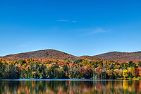 Scenic Colton Pond and autumn foliage, Killington, Vermont, USA.