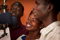 Eye Radio broadcasters From left, CLEMENT LOBOL, VIOLA ELIAS AND MULU FRANCIS, record a radio commercial at their Juba station in South Sudan. In an effort to build up media and encourage a free media, USAID funded the station which is run by Internews.
