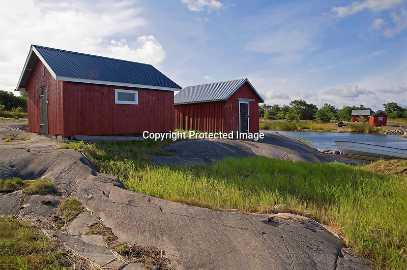 Boat Sheds on Sunny Morning on the Island of Kökar in Åland