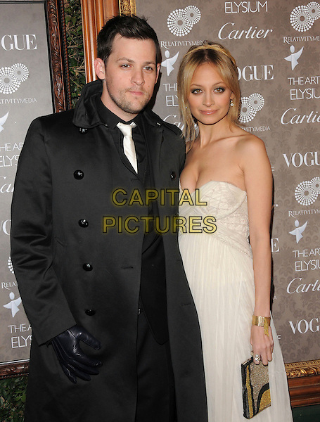 "JOEL MADDEN & NICOLE RICHIE .at The 2nd Annual Art of Elysium Black Tie Charity Gala ""Heaven"" held at The Vibiana in Los Angeles, California, USA,  January 10th 2009.                                                                     .half length black coat strapless white dress clutch bag gloves couple plait braid hair up long maxi .CAP/DVS.©Debbie VanStory/Capital Pictures"