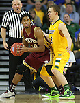 SIOUX FALLS, SD - MARCH 7: Cam Griffin #30 of Denver looks to pass against Paul Miller #2 from North Dakota State in the first half of their Summit League Tournament game Saturday night at the Denny Sanford Premier Center in Sioux Falls, SD. (Photo by Dick Carlson/Inertia)