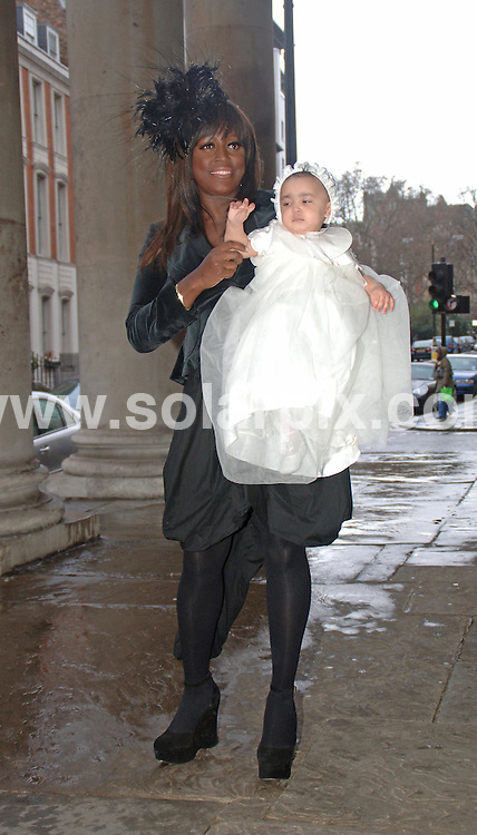 **ALL ROUND PICTURES FROM SOLARPIX.COM**.**WORLDWIDE SYNDICATION RIGHTS**.Mica Paris and her partner Andreas Neumann celebrate the christening of their daughter Russia May at St Georges Church, near Hanover Square in west London on 18.03.07...JOB REF:   3524   FMF           DATE: 18.03.07.**MUST CREDIT SOLARPIX.COM OR DOUBLE FEE WILL BE CHARGED* *UNDER NO CIRCUMSTANCES IS THIS IMAGE TO BE REPRODUCED FOR ANY ONLINE EDITION WITHOUT PRIOR PERMISSION*