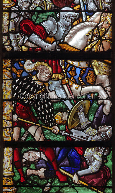 Stained glass window of the Battle of Clavijo, when St James Matamoros, or St James the Moor-slayer, appeared to fight with the christians against the Moors, c. 1525, by Mathieu Bleville, at the Church of Notre Dame en Vaux, Chalons-en-Champagne, Champagne-Ardenne, France. The window was restored in 1901. St James Matamoros is the name for the apostle St James the Elder who appeared during the battle according to legend. The church is listed as a UNESCO World Heritage Site as part of the Santiago de Compostela pilgrimage site. Picture by Manuel Cohen