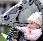 The youngest Iroquois fan checks out the race-day program.