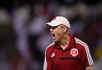 Richmond Kickers head coach Leigh Cowlishaw reacts to a referee's call during a third round match in the US Open Cup at City Stadium in Richmond, VA.  D.C. United advanced on penalty kicks after tying the Richmond Kickers, 0-0.