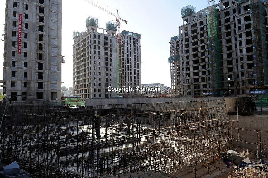 A construction site in Kangbashi district of the Chinese city of Ordos, Inner Mongolia. 12-May-2011