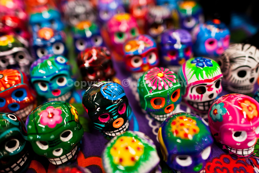Colorful hand painted skulls are sold on the market during the Day of the Dead festival in Mexico City, Mexico, 28 October 2016. Skulls, skeletons and the other death symbols are used to adorn graves, altars and offerings during the Day of the Dead (Día de Muertos). A syncretic religious holiday, combining the death veneration rituals of the ancient Aztec culture with the Catholic practice, is celebrated throughout all Mexico. Based on the belief that the souls of the departed may come back to this world on that day, people gather at the gravesites in cemeteries, praying, drinking and playing music, to joyfully remember friends or family members who have died and to support their souls on the spiritual journey.