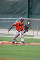 GCL Astros first baseman Jose Alvarez (6) stretches for a throw during a Gulf Coast League game against the GCL Marlins on August 8, 2019 at the Roger Dean Chevrolet Stadium Complex in Jupiter, Florida.  GCL Astros defeated GCL Marlins 4-2.  (Mike Janes/Four Seam Images)