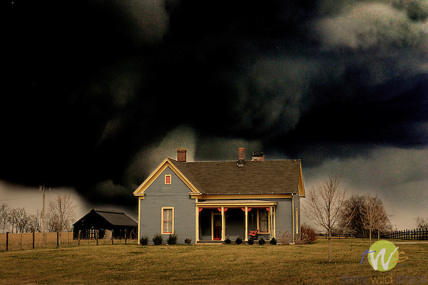 Rural Kentucky home with stormy clouds.