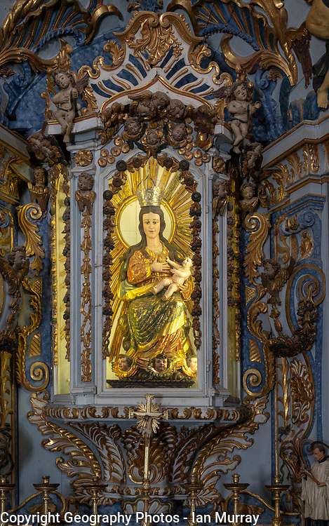 Ornately decorated statue of Blessed Virgin Mary 17th century church of Igreja de Santiago, Tavira, Algarve, Portugal, Southern Europe
