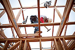 Gerraldo Zambrano works on a new home being built in a Folsom, California development, March 15, 2013.
