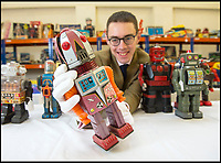 BNPS.co.uk (01202 558833)<br /> Pic: PhilYeomans/BNPS<br /> <br /> Auctioneer Richard Edmonds with the 1960 vintage X-70 'Tulip Head Space Robot' worth &pound;1000.<br /> <br /> Take me to your leader - out of this world collection of rudimentary robots from the earliest days of sci-fi.<br /> <br /> The huge collection of over 500 classic sci-fi toys dates back to the 1950's and 60's and could now be worth a whopping &pound;30,000.<br /> <br /> The huge collection was started by a robot mad schoolboy in the 1950's as the Russian Sputnik satellite kick started the race for space and sparked huge interest in science fiction.<br /> <br /> The oldest items date from the late 1950's with models continuing all the way through to the 1990s with several classic favourites included.<br /> <br /> There are a number of lots related to TV classic Thunderbirds and a model of Robbie the Robot, who featured in the TV series Lost in Space and the film Forbidden Planet remains in terrific condition.