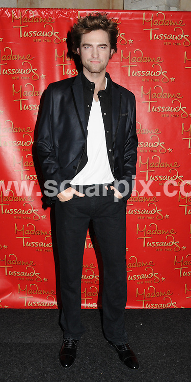 **ALL ROUND PICTURES FROM SOLARPIX.COM**.**SYNDICATION RIGHTS FOR UK, AUSTRALIA, DENMARK, PORTUGAL, S. AFRICA, SPAIN & DUBAI (U.A.E) & ASIA (EXCLUDING JAPAN) ONLY**.Robert Pattinson Wax Figure Unveiling at Madame Tussauds in New York City on March 25..This pic:   Robert Pattinson waxwork.JOB REF:  10991   PHZ/ Mayer    DATE: 26.03.10.**MUST CREDIT SOLARPIX.COM OR DOUBLE FEE WILL BE CHARGED**.**MUST NOTIFY SOLARPIX OF ONLINE USAGE**.**CALL US ON: +34 952 811 768 or LOW RATE FROM UK 0844 617 7637**