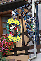 wrought iron sign hotel restaurant auberge alsacienne eguisheim alsace france
