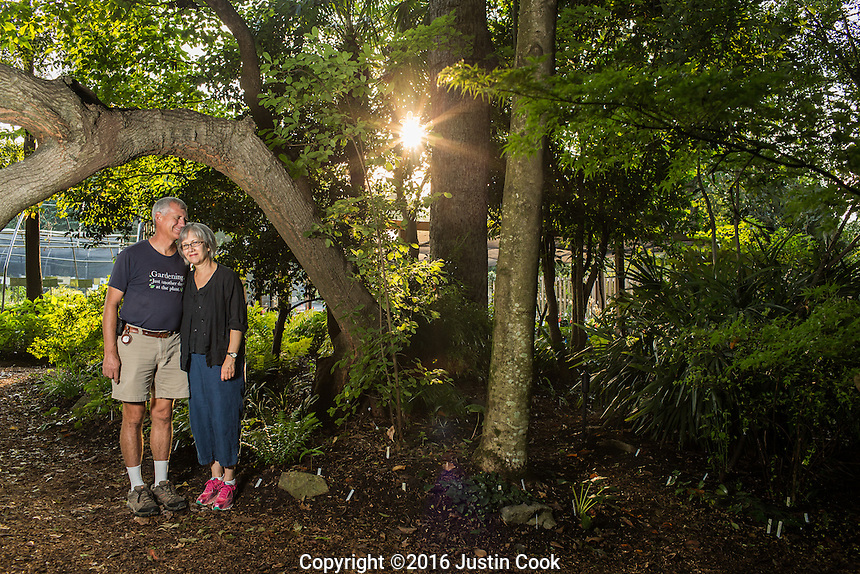 Horticulturalist and Plantsman Tony Avent and his wife/partner Anita pose for portraits by one of their favorite oak trees at Plant Delights Nursery and Juniper Level Botanic Garden in Raleigh, NC on Friday, August 26, 2016. (Justin Cook)
