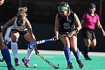 26 September 2014: Duke's Sarah Furey (2) and California's Andrea Earle (left). The Duke University Blue Devils hosted the University of California Bears at Jack Katz Stadium in Durham, North Carolina in a 2014 NCAA Division I Field Hockey match. Duke won the game 2-0.