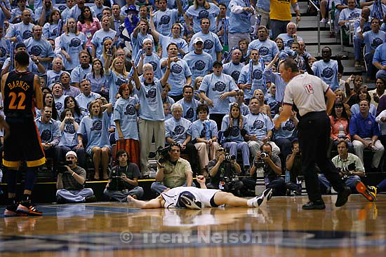 Fans protest a foul called on Utah Jazz forward Matt Harpring (15, prone on court). Salt Lake City - Utah Jazz vs. Golden State Warriors, NBA Playoffs basketball, second round, Game Two, at EnergySolutions Arena.