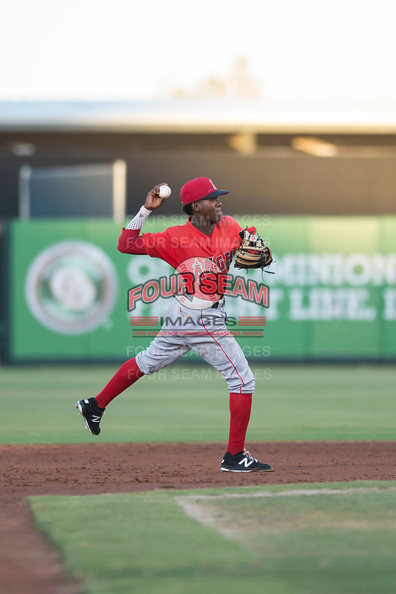 AZL Angels shortstop Daniel Ozoria (23) throws to first base during an Arizona League game against the AZL Indians 2 at Tempe Diablo Stadium on June 30, 2018 in Tempe, Arizona. The AZL Indians 2 defeated the AZL Angels by a score of 13-8. (Zachary Lucy/Four Seam Images)