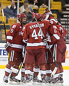 Danny Biega (Harvard - 9), Max Everson (Harvard - 44), Ryan Grimshaw (Harvard - 6) - The Harvard University Crimson defeated the Northeastern University Huskies 3-2 in the 2012 Beanpot consolation game on Monday, February 13, 2012, at TD Garden in Boston, Massachusetts.
