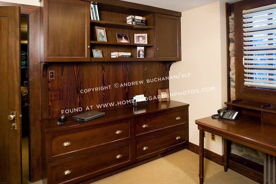 Dark wood built-ins provide ample storage space in a home office. this image is available through an alternate architectural stock image agency, Collinstock located here: http://www.collinstock.com
