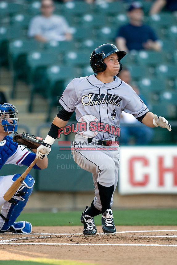 Omaha Storm Chaser outfielder David Lough blasts a first inning home run into the bullpen against the Round Rock Express in Pacific Coast League baseball on Monday April 11th, 2011 at Dell Diamond in Round Rock Texas.  (Photo by Andrew Woolley / Four Seam Images)
