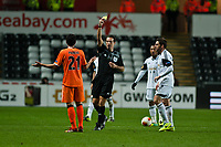 Thursday 28 November  2013  Pictured:Dani Parejo recieves  a yellow card from Referee Luca Banti <br /> Re:UEFA Europa League, Swansea City FC vs Valencia CF  at the Liberty Staduim Swansea