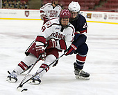 Jake Horton (Harvard - 19), Randy Hernandez (NTDP - 20) - The Harvard University Crimson defeated the US National Team Development Program's Under-18 team 5-2 on Saturday, October 8, 2016, at the Bright-Landry Hockey Center in Boston, Massachusetts.