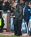 St Johnstone manager Steve Lomas looks down as his team lose to Hearts.