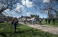 peloton passing a local chateau during the 33th Tro Bro Léon 2016