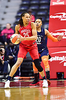 Washington, DC - June 3, 2018: Washington Mystics forward Monique Currie (25) is guarded by Connecticut Sun guard Alex Bentley (20) during game between the Washington Mystics and Connecticut Sun at the Capital One Arena in Washington, DC. (Photo by Phil Peters/Media Images International)