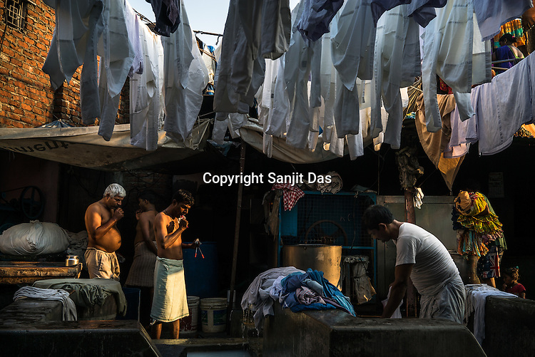 Washermen(locally known as Dhobis) brush teeth while others wash clothes at the Laundromat in Dhobighat in India's financial capital, Mumbai, India. The laundry comes from different sections of the society - from hospital to hospitality to garment factories and normal households.