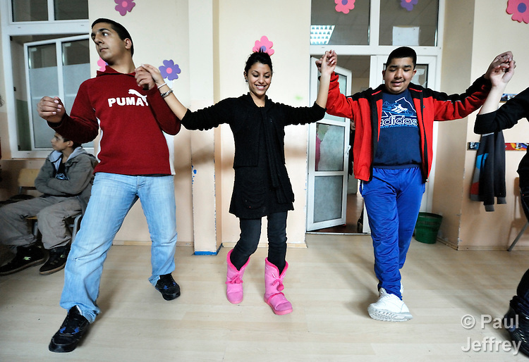 Bajram Kruezi (left) participates in a traditional Roma dance along with other students in the Branko Pesic School, an educational center for Roma children and families in Belgrade, Serbia, which is supported by Church World Service. Kruezi's family came to Belgrade as refugees from Kosovo, and like many Roma can't afford regular school fees. Many Roma also lack legal status in Serbia, and thus have difficulty obtaining formal employment and accessing government services.