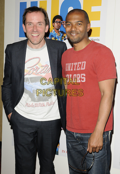 "Ben Miller & Noel Clarke.The ""Huge"" UK premiere, Empire Cinema, London, England..June 27th, 2011.half length car print black suit jacket white  red t-shirt united colors .CAP/CAN.©Can Nguyen/Capital Pictures."