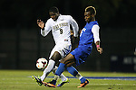 25 October 2013: Wake Forest's Sean Okoli (9) and Duke's Sebastien Ibeagha (5). The Duke University Blue Devils hosted the Wake Forest University Demon Deacons at Koskinen Stadium in Durham, NC in a 2013 NCAA Division I Men's Soccer match. The game ended in a 2-2 tie after two overtimes.