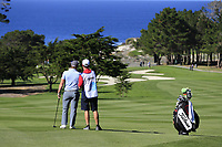 Paul Dunne (IRL) and caddy Darren Reynolds on the 1st hole during Thursday's Round 1 of the 2018 AT&amp;T Pebble Beach Pro-Am, held over 3 courses Pebble Beach, Spyglass Hill and Monterey, California, USA. 8th February 2018.<br /> Picture: Eoin Clarke | Golffile<br /> <br /> <br /> All photos usage must carry mandatory copyright credit (&copy; Golffile | Eoin Clarke)
