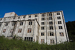 "The Buckner Building, Whittier, Alaska - ""A city under one roof"". Built in 1953, this derelict building was abandoned but can't be demolished due to the amount of asbestos inside. It was damaged by earthquake in  1964.....The strangest town in Alaska, Whittier - only reachable by tunnel or ship. It's a stop off point for Cruise ships, and the Alaska raildroad. 90% of inhabitants live in one building! Originally established as a military base during World War two."