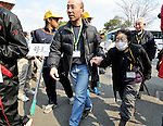 March 30, 2011, Kazo, Japan - People from Futabamachi, a small town neighboring a crippled nuclear power plant in Fukushima prefecture, arrive at their new shelters in Kazo in Saitama prerecture, 50 km north of Tokyo, on Wednesday, March 30, 2011. About 1,200 residents of Futabamachi, near the trouble-stricken Fukushima No.1 nuclear power plant located some 240 km northeast of Tokyo, were relocated to the now-defunct prefectural Kisai High School in Kazo along with the town government functions. (Photo by AFLO) [3620] -mis-