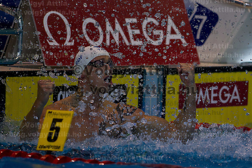 Frederc Bousket of France celebrates his victory in the Men's 50m Freestyle final of the 31th European Swimming Championships in Debrecen, Hungary on May 27, 2012. ATTILA VOLGYI
