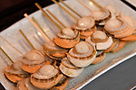 Japanese street food, grilled scallops, Hotate-yaki, on a stick in Kyoto, Japan
