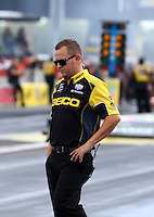 Aug. 31, 2013; Clermont, CA, USA; Richie Crampton , crew member for NHRA top fuel dragster driver Morgan Lucas (not pictured) during qualifying for the US Nationals at Lucas Oil Raceway. Mandatory Credit: Mark J. Rebilas-