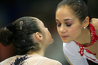 Irina Tchachina of Russia receives embrace from Anna Bessonova of Ukraine during event final medals ceremony at World Championships at Baku, Azerbaijan on October 6, 2005. (Photo by Tom Theobald)