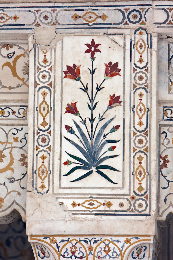 "Agra, India.   Pietra Dura Stonework at the Itimad-ud-Dawlah, Mausoleum of Mirza Ghiyas Beg.  The tomb is sometimes referred to as the ""Baby Taj.""  It is one of the finest examples of pietra dura work, the use of inlaid colored stones to make floral or geometric designs."