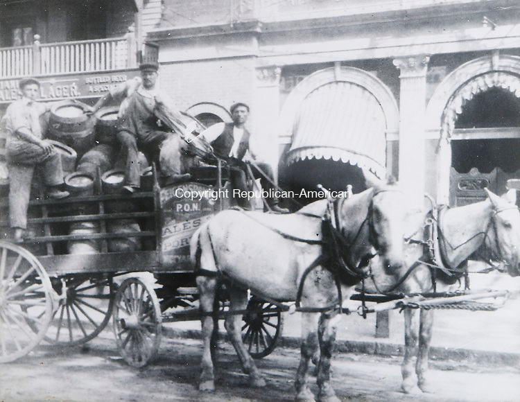 TORRINGTON, CT -16 June 2005 -061605BZ01- Immigrants delivering beer on East Main Street, Torrington in 1915. - Photo courtesy of Venetian Restaurant, Torrington