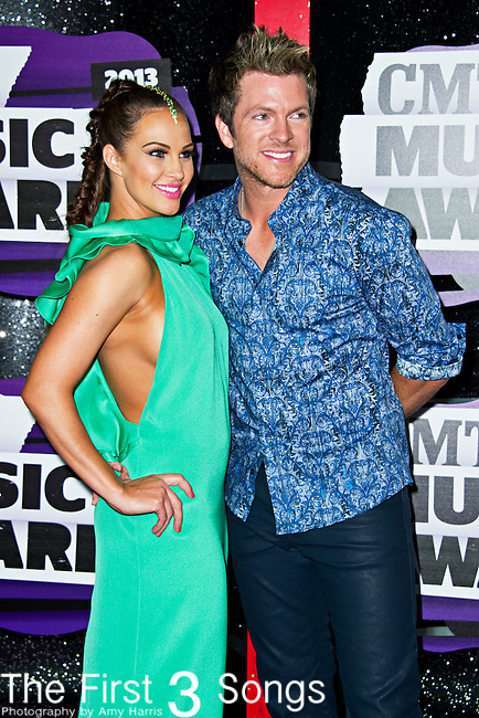Tiffany Fallon and Joe Don Rooney of Rascal Flatts arrive at the 2013 CMT Music Awards at Bridgestone Arena in Nashville, Tennessee.