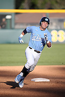 Logan Warmoth (7) of the North Carolina Tar Heels runs the bases during a game against the UCLA Bruins at Jackie Robinson Stadium on February 20, 2016 in Los Angeles, California. UCLA defeated North Carolina, 6-5. (Larry Goren/Four Seam Images)