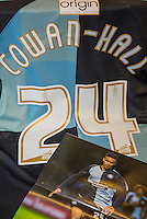 Paris Cowan-Hall of Wycombe Wanderers shirt and programme during the Sky Bet League 2 match between Wycombe Wanderers and Luton Town at Adams Park, High Wycombe, England on 6 February 2016. Photo by Massimo Martino / PRiME Media Images.