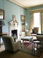 The blue sitting room is furnished in a timelessly elegant style whilst the George I marble fireplace provides a stunning focal point to the room.