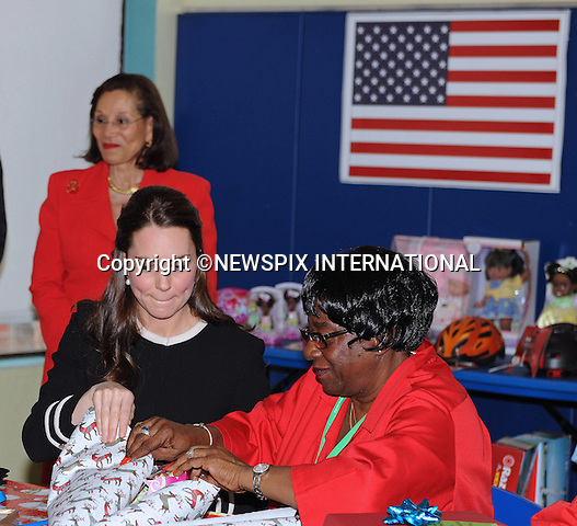 08.12.2014; New York, USA: KATE MIDDLETON<br /> visits Northside Center for Child Developement in Harlem,where she helped volunteers in gift-wrapping Christmas present.<br /> She also viewed students undertake a craft- making exercise.<br /> The Duchess was accompanied by the First Lady of New York, Chirlane_McCray.<br /> Mandatory Photo Credit: &copy;NEWSPIX INTERNATIONAL<br /> <br /> **ALL FEES PAYABLE TO: &quot;NEWSPIX INTERNATIONAL&quot;**<br /> <br /> PHOTO CREDIT MANDATORY!!: NEWSPIX INTERNATIONAL(Failure to credit will incur a surcharge of 100% of reproduction fees)<br /> <br /> IMMEDIATE CONFIRMATION OF USAGE REQUIRED:<br /> Newspix International, 31 Chinnery Hill, Bishop's Stortford, ENGLAND CM23 3PS<br /> Tel:+441279 324672  ; Fax: +441279656877<br /> Mobile:  0777568 1153<br /> e-mail: info@newspixinternational.co.uk